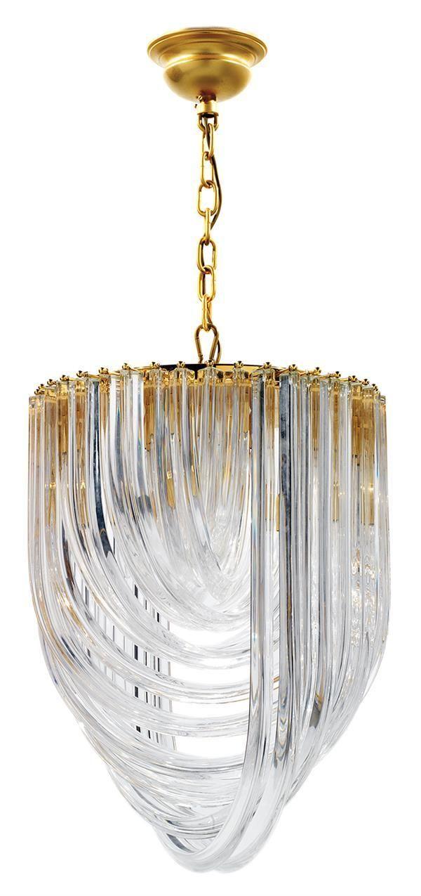 Tajan - Tajan Live Auctions Ludovico DIAZ DE SANTILLANA (1931-1989) Suspension à structure circulaire en métal doré, soutenant quatre brassées de tubes en verre translucide triangulé, chaîne d'accrochage et cache-bélière en métal doré. (Un tube à réajuster). Haut. 128cm - Diam. 52cm