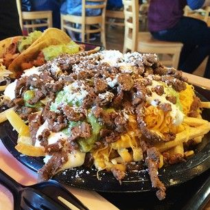 They're then finished off with some sour cream and guac, thus creating an explosion of flavor. | You Haven't Lived Until You've Tried Carne Asada Fries