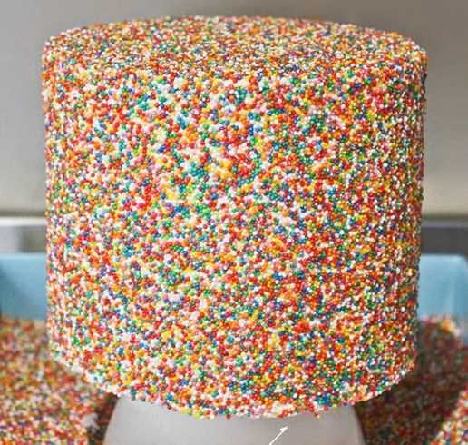 Cake decorated with lots and lots of sprinkles.