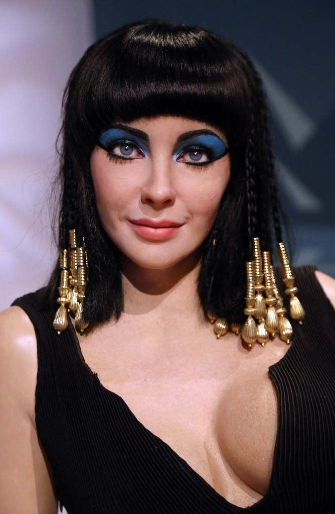 Sexy Last-Minute Halloween Makeup Ideas - Elizabeth Taylor's modern take on Egyptian queen, Cleopatra. Go for graphic winged cat eye and extend blue shadow all the way to your brow.