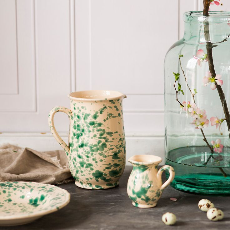 """Hand-painted and glazed using traditional methods, this earthenware pitcher is made by a family-owned Italian company with 400 years of history. The Spruzzi collection takes its name from the decorative technique used to create its speckled pattern, a customary style from the Italian countryside that gained popularity in the 1960s.- Hand-glazed and painted earthenware- Dishwasher safe- Handmade in Italy8.4""""H, 8.25""""D, 5"""" diameterUS Exclusive"""