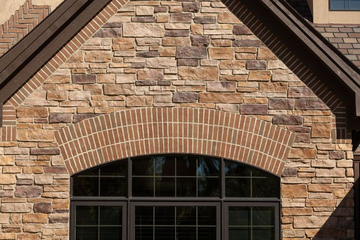 Combination of brick stone exterior this house uses for Brick stone combinations