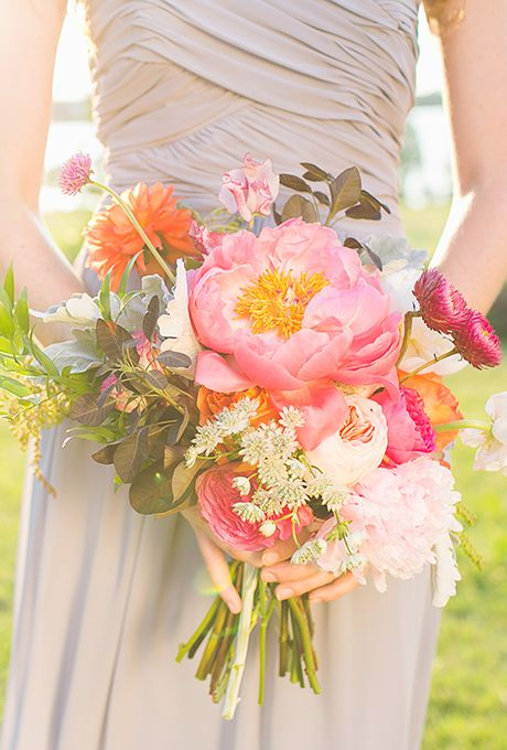 Brides: Bouquet of Coral Charm Peonies and Dahlias. Bouquet of coral charm peonies, dahlias, garden roses, sweet peas, ranunculuses, strawflowers, Italian ruscus, astrantias, cotinus, and gomphrena, $195, The Southern Table