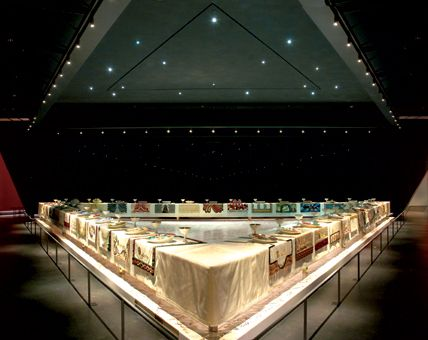 Judy Chicago, The Dinner Party, 1974-79, an important icon of 1970s feminist art and a milestone in twentieth-century art. 'The Dinner Party' comprises a massive ceremonial banquet, arranged on a triangular table with a total of thirty-nine place settings, each commemorating an important woman from history.