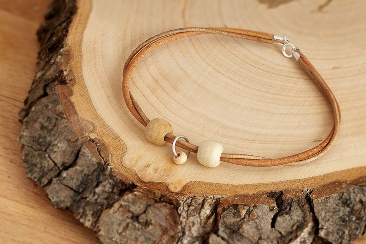Personalized Bracelet, Mom + Dad + Baby, Sterling Silver clasp with Wooden Beads from the same year when you and your loved ones born. by MsHeartwoodJewellery on Etsy  Photos by: http://www.silverlightstudio.co.uk/