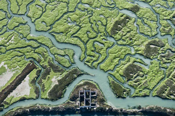 SPAIN / ANDALUSIA / Nature / Landscapes - Marshes of Doñana, National Park, Huelva, Andalusia, Spain . Marismas mareales durante una bajamar equinoccial en la que quedan al descubierto los fondos limosos de la Bahía de Cádiz.