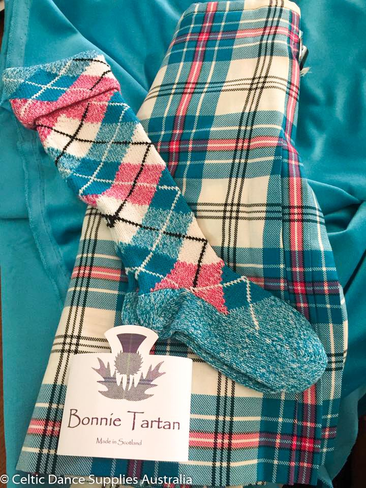 A very happy customer from Townsville, Queensland, Australia. New Thistle Aqua tartan kilt and matching whole diamond with alternating marl hose, both made by Bonnie Tartan Limited. Matching Bonnie Aqua velvet ready to make her vest ready for her first competition in 2017. Photo courtesy of Celtic Dance Supplies Australia.
