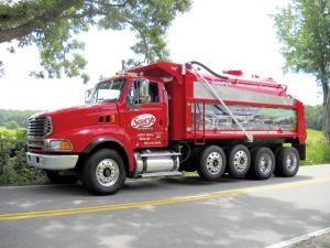 May 2012- Owner John Soucy purchased this bright red 2005 Sterling LT9500 quad-axle and had it outfitted by Vacutrux Limited with a dump body and 3,000-gallon steel tank with vacuum provided by a Wallenstein 40HVOA air-cooled pump. The truck is powered by a Mercedes-Benz 450 hp 6-cylinder diesel wed to an Allison 500 automatic transmission. The tank has dished heads, top lifting lugs, full-height baffles and a dome-style topside manway.