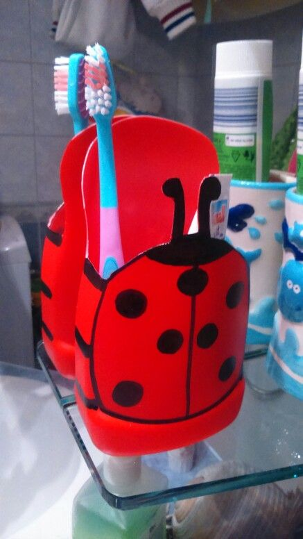 Ladybird toothpaste and toothbrush holder made from a plastic ketchup bottle