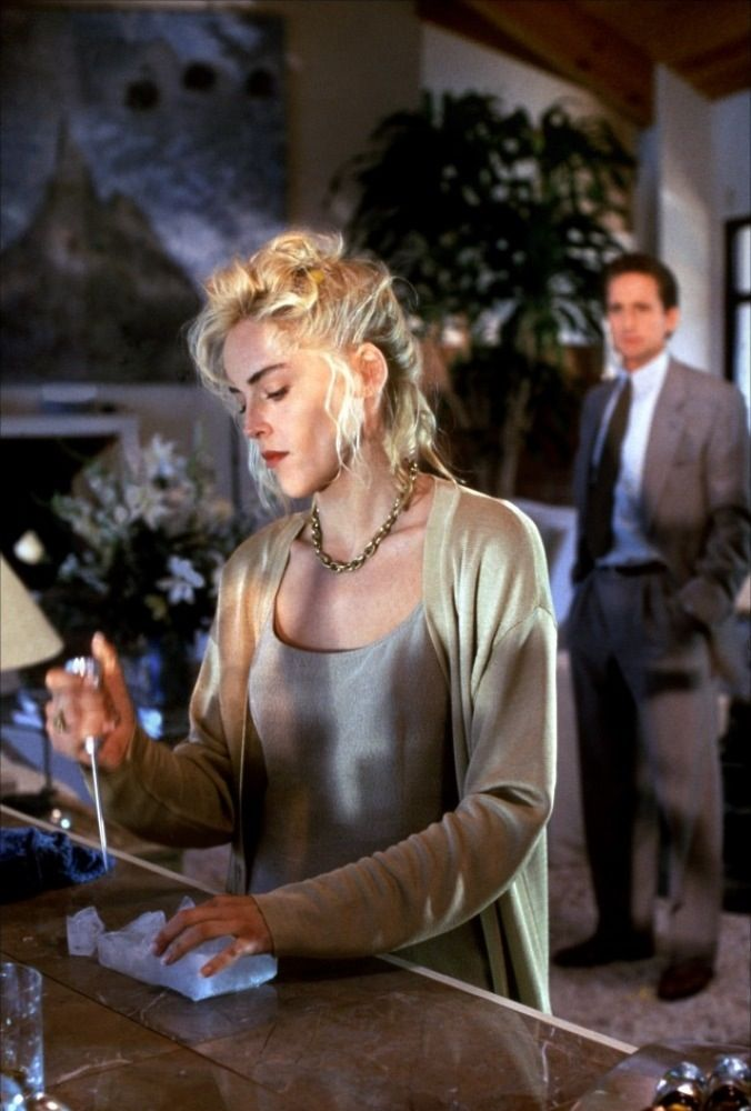 Sharon Stone as Catherine Tramell in Basic Instinct, 1992.  Luxe, slinky fabrics and a real Madonna vibe, no?
