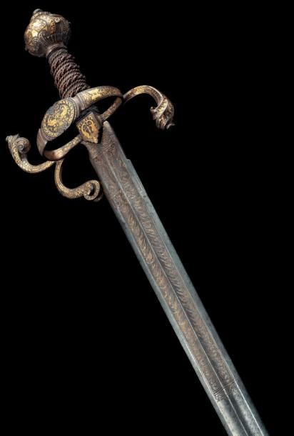 Beautiful gold damascened sword facing in the Italian Mannerist taste and perhaps inspired by drawings of Filippo Orsini Mantua around 1554, the nineteenth century.