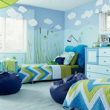 """Shades of blue pair with green to create an amphibian-theme room, perfect for the boy who is forever catching frogs and turtles, and asking, """"Can we keep him?"""" A wall mural evokes a by-the-pond look, and durable cotton bedspreads and pillowcases will stand up to rough boy antics. Consider using built-in shutter shades on windows rather than bulky curtains."""