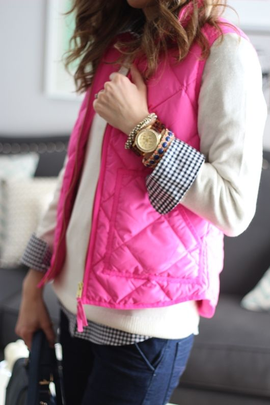 pink vest, white sweater with navy gingham shirt and jeans