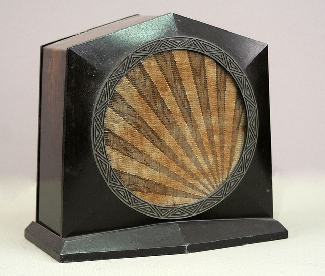 This is a radio set of Art Deco style. The angled shape is ...