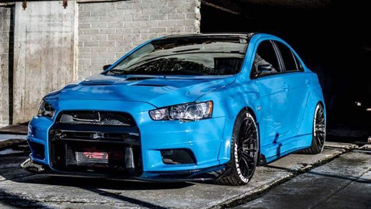 This EVO looks fly wrapped in Avery Dennison SW900 Gloss Light Blue by 253 Wrapz, https://m.facebook.com/253WrapZ-135813223255774/