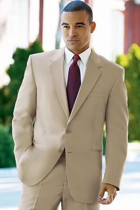 A tan suit is a bit more casual than the traditional black tuxedo.