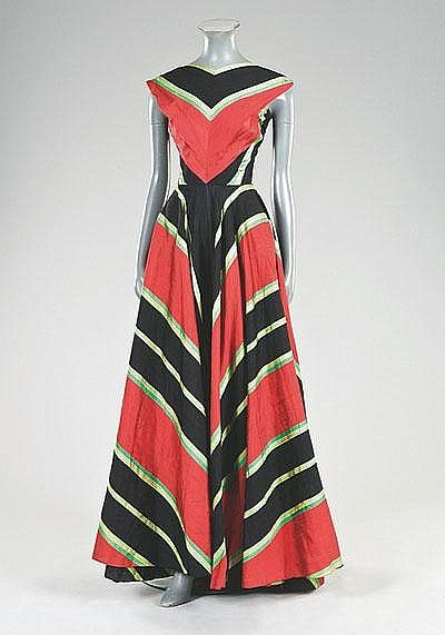 * Madame Grès boldy striped slubbed silk ball gown, 1953, labelled, the bodice cut so that the stripes converge at the centre-front, with finely pleated bands of silk slanting in opposite directions from the armholes, the stripes to the voluminous skirt slant diagonally, cut in four shaped gores,