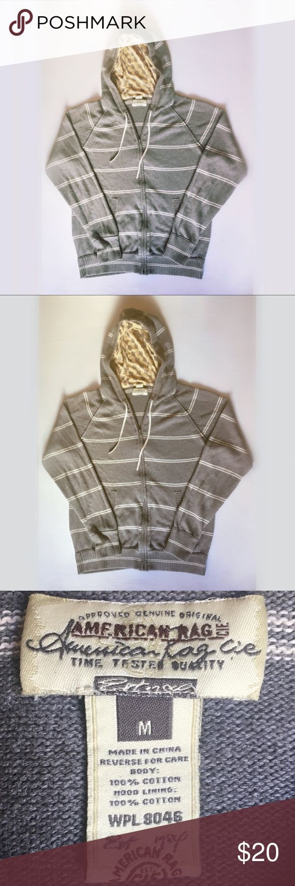 American Rag hoodie sweater American Rag hoodie sweater. Grey with cream stripes, full zip, front pockets, & lined hood. Supersoft and cozy 100% cotton. Like new condition. Size medium. American Rag Sweaters Zip Up