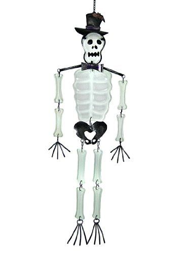 Cool Metal And Glass Skeleton Wind Chime by Things2Die4. $29.99. Glass Bones and Skull. Metal Frame, Hat, Hips and Hands. 25 Inches Long, 7 1/2 Inches Wide. This cool metal and glass skeleton wind chime is great for Halloween or all year round! The skeleton's hat, bow-tie, shoulders, pelvis, hands and feet  are made of metal, and his bones are made of pieces of thick, interconnected white glass that create a soothing tinkling sound when the wind knocks them into the metal piece...