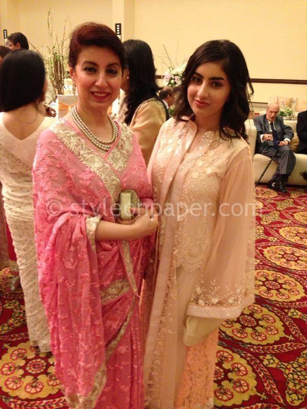 Elegant guest at a Pakistani wedding. Sari pallu worn to highlight the multi strand Pearl necklace