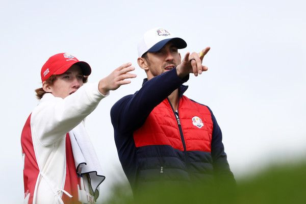 Michael Phelps Photos Photos - Swimmer Michael Phelps of the United States discusses a shot during the 2016 Ryder Cup Celebrity Matches at Hazeltine National Golf Club on September 27, 2016 in Chaska, Minnesota. - 2016 Ryder Cup - Celebrity Matches