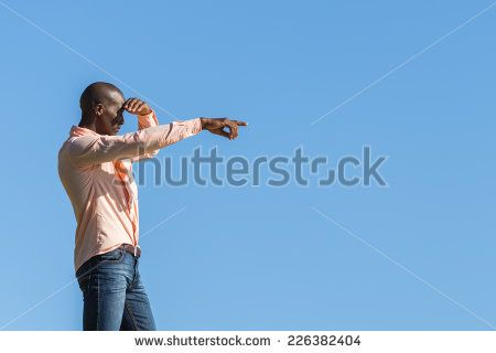 http://www.shutterstock.com/pic-226382404/stock-photo-african-black-man-standing-on-a-high-rock-overlooking-cape-town-as-he-points-and-scouts-the-blue.html?src=WuffEuvvGWj02MQSGcnIHQ-1-15 African Black Man, Standing On A High Rock Overlooking Cape Town As He Points And Scouts The Blue Sky, Ocean And Mountains On A Sunny Summers Day Stock Photo 226382404 : Shutterstock