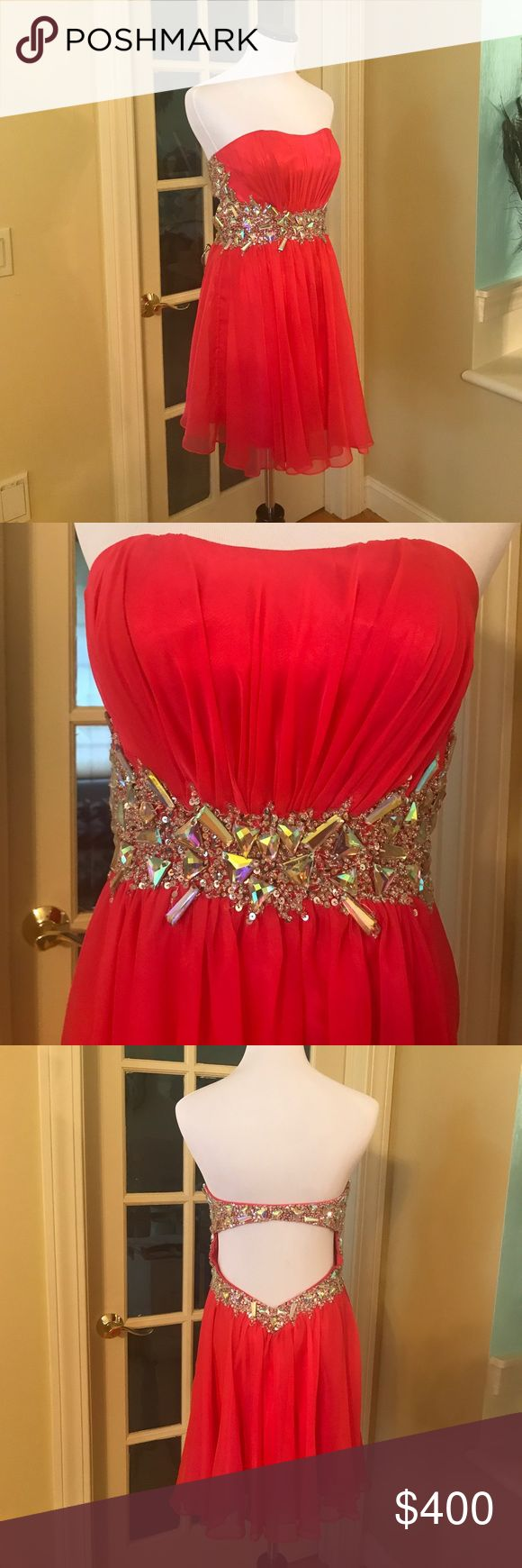 Cocktail dress Coral cocktail dress with heavy crystal and rhinestone embellishments. Strapless and low back makes this perfect to party in! Great for a prom or wedding. Only worn once, like new condition. Size 4 Dresses Strapless