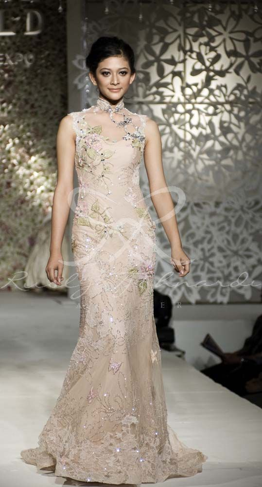 Soft cream cheongsam gown collection by Rusly Tjohnardi Atelier