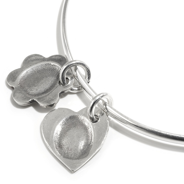 Flower & heart pendant on silver bangle by Smallprint. www.smallprint.com