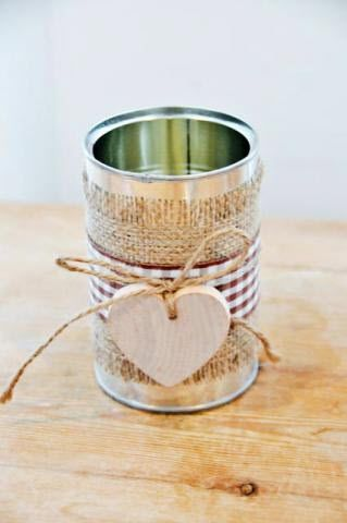 Scraps of canvas, pretty ribbon & a wooden ornament tied in twine dress a simple soup can-turned votive for inclusion on any party table's centerpiece! / EHH