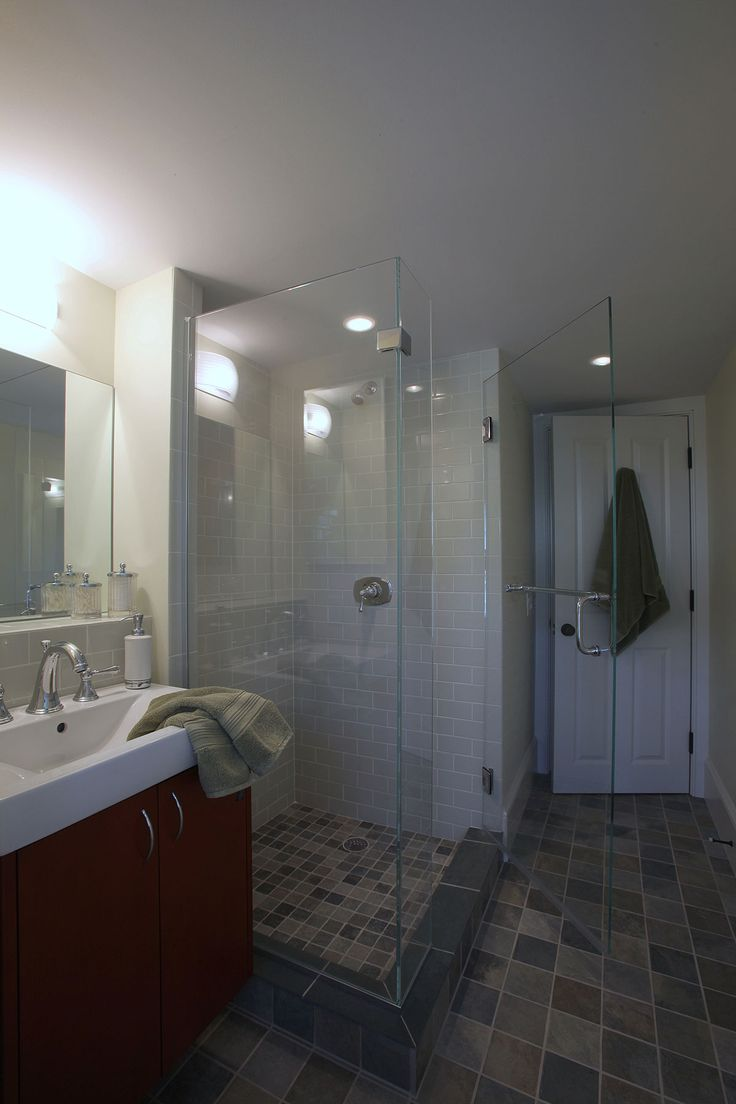 Custom Built Cape Cod Bathroom With Tile Floors And Glass Enclosed Shower.  By Cape Associates