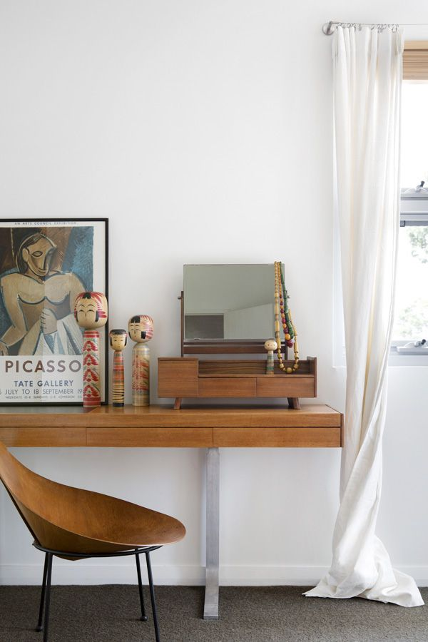 Bedroom details. Japanese kokeshi dolls sit on 1954 Danish Moller sideboard, and 1950′s Roger McLay ply Cone chair.