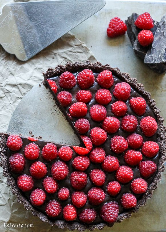 This No-Bake Raspberry Chocolate Tart comes together in just ten minutes! The no-bake chocolate crust is filled with vegan chocolate ganache and topped with fresh raspberries for a decadent, guilt-free treat.