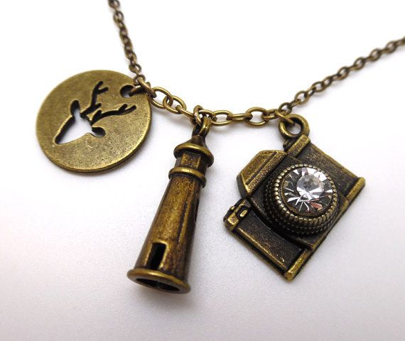 Wear everything that made Life is Strange so amazing around your neck with this game charm Necklace. The deer, the lighthouse and the camera. There's no question what game this necklace is referring to.