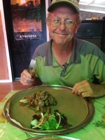 Customer having a meal at Harambe, an Ethiopian restaurant in Columbia, South Carolina.