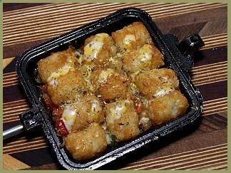 Boondockers pie Iron cooking! This is the best website for pie iron recipes, especially like the garlic tater tots pictured above. Cooking with pie irons is a delicious way to cook in a campfire. Just put in your ingredients, close the pie iron, and let sit in the fire until it is ready. Have fun cooking! - Rugged Thug