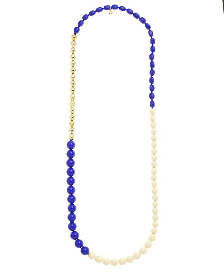 Collana lunga con sfere bianche, blu e dorate di diverse dimensioni