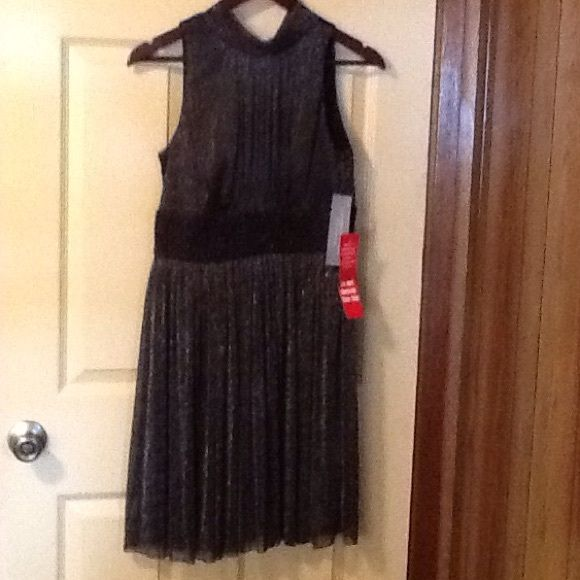 London Times Petites Formal Dress New w/tags New with tags. London Times Petite is a Formal Dress it is black and silver in color. It is size 8P.  It is made of 97% polyester and 3% spandex.  Lining is 100% polyester. Dry clean.  Great dress to wear for a special occasion. Reasonable offers only please and No low balling. London Times Dresses High Low