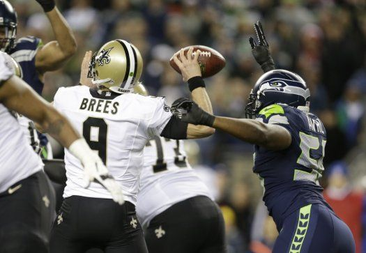 Seahawks DE Cliff Avril causes NOSaints QB Drew Brees to fumble in the first half of Monday Night Football game - DE Michael Bennett recovers and runs it in for a TD! First Blood. #GoHawks Game photos: New Orleans Saints at Seattle Seahawks - Seattle Seahawks & NFL News