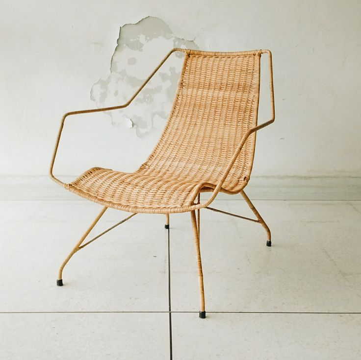 Designed by influential Brazilian designers Carlo Hauner and Martin Eisler the chair, made from wrought iron and wrapped in reed, shows the softer side of Modernism. Quite a feat for a chair made form iron.
