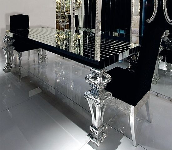 insanely gorgeous dining room!! BLACK GLASS this would look amazing in the all white living room.