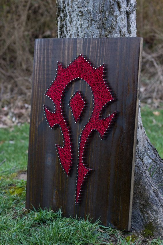MADE TO ORDER World of Warcraft Horde String Art  This item is made to order and will be ready to ship in 1-2 weeks. You will receive communication from me once complete and when your item is shipped.  Made with wood, stain, nails, and string. It comes ready to hang, measures 17.5x24x2 and weighs approximately 5lbs.  This item is made to order, so the design will be the same but your piece will be unique!  PLEASE NOTE: Each made to order piece will look slightly different than the picture…