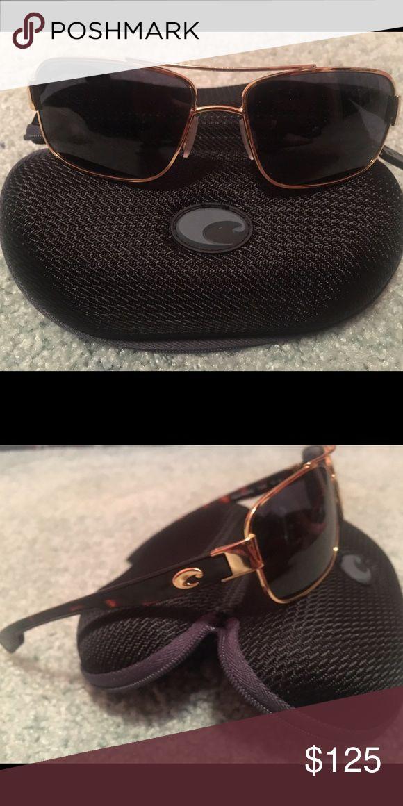 Costa Sunglasses Tower style. Plastic gray lenses with gold frames. Real authentic Costa Del Mars. Costa Del Mar  Accessories Sunglasses