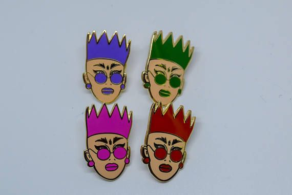 Hard Enamel Pins of Sasha Velour   1. Pins come in 4 different colours, 2.5cm in height Made of brass material and gold coloured plating  2. Club Kid runway look Pin is 4cm in height made of brass material and has a rubber backing, The pink and blue parts of the pin glow in the dark!