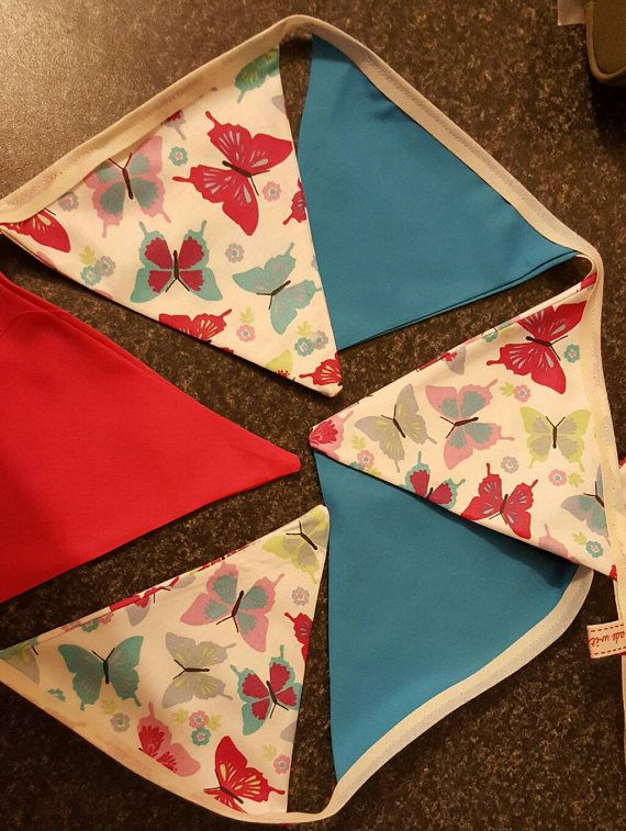 Check out this item in my Etsy shop https://www.etsy.com/uk/listing/492147752/butterfly-pinks-and-blues-bunting