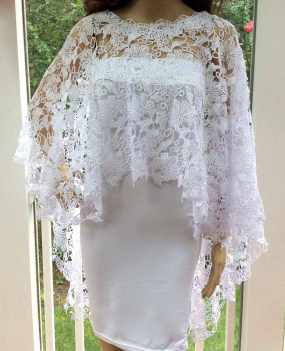 This fabulous lace cover up creates a sparkling elegance for any formal occasion.  Made in white or ivory.  Very Gatsby-Art Deco feel.  Perfect addition to any formal wear.  Available in small, medium, large or extra large.