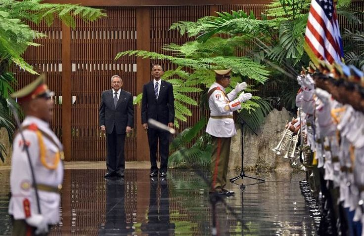 US President Barack Obama stands next to Cuban President Raul Castro at the Revolution Palace in Havana