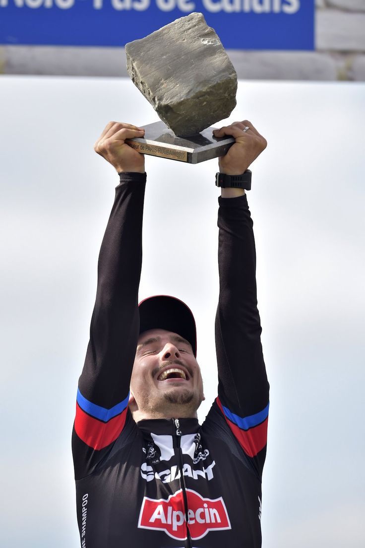 John Degenkolb holds the pave' trophy aloft for the 2015 Paris - Roubaix