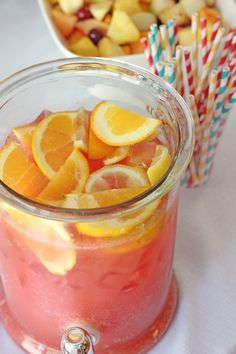 BEST PARTY PUNCH,EVER (makes about a gallon)...1c frzn concentrated lemonade (thaw),6oz frzn concentrated orange juice (thaw),2c cranberry juice,3c water,1/4c super fine sugar,2liters lemon-lime soda-chill, Freshly sliced lemons & oranges, Ice...Add lemonade+orange juice+cranberry juice+water+sugar to a container w/lid. Stir until sugar is dissolved. Cover; chill mixture 1-2hrs. TO SERVE: add mixture to drink server+soda+ice+fruit slices.Stir.  **If desire alcohol version: add few splashes…