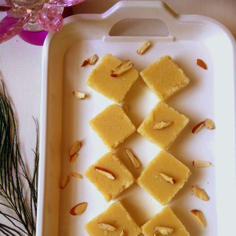 Milk Sooji Fudge is rich creamy, aromatic fudge made of milk and milk products. It's very simple to prepare with no fuss. The rava or semolina or sooji can be replaced with other flours like besan, maida or wheat flour. Do try this simple dessert suitable for any festive occasion. Serve Milk Sooji Fudge Recipe along with Masala Chai Recipe - Indian Spiced Tea when there are guests at home. If you like this recipe, try more recipes like Parwal Ki Mithai Recipe (Poin...